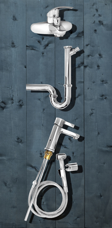 valves, pipes, sanitary ware chrome-plated products on a wooden background