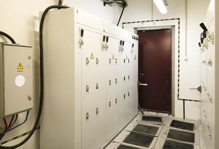 switchboard cabinets with metal, rubber mats on the floor and handle switches, without staff