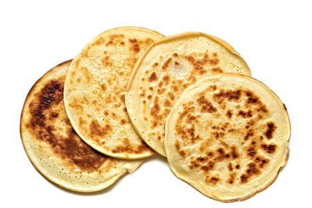 four round pancakes in white plate on a table Stock Photo