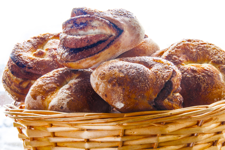 fresh pastries buns, sprinkled with cinnamon and sugar in the basket