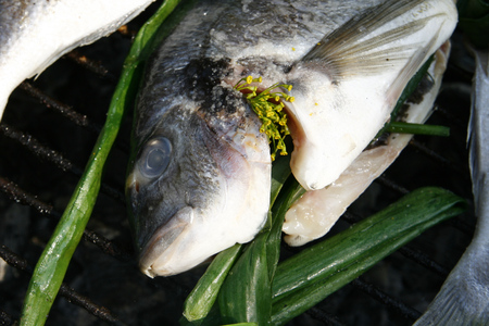 coal fish: On the grill lies prepared for frying fresh fish.
