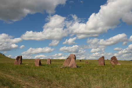 pillars: In the Siberian steppes are megaliths, stone pillars. Ancient burials. Stock Photo