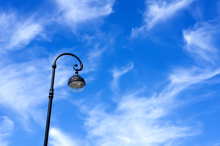 electric fixture: Street lamp on background of blue sky Stock Photo