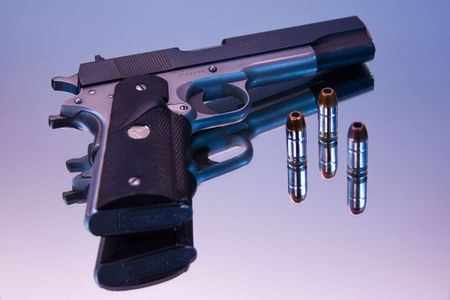 Semi-Automatic 45 Magnum with shells photo