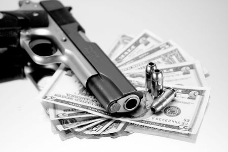 Black & White, 45 Magnum resting on US bills with bullets Stock Photo - 2416199
