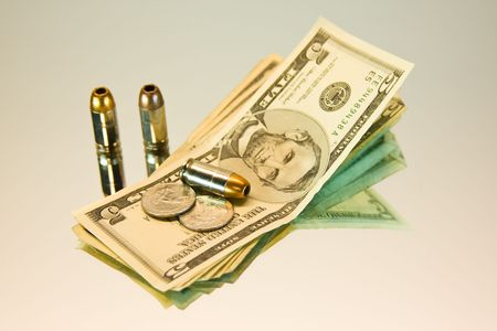 the godfather: Bullets on top of five dollar bills. Suitable for narcotrafic, or crime topics