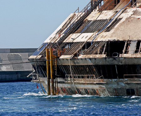 flotation: Ship Costa Concordia towed to the port of Genoa