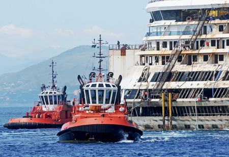 tonnage: Ship Costa Concordia towed to the port of Genoa