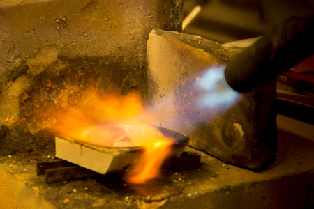 molted: Melting of silver for a casting, melting of silver for a cast Stock Photo