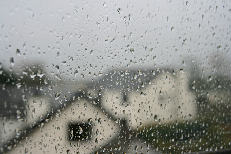 surface tension: raindrops on window