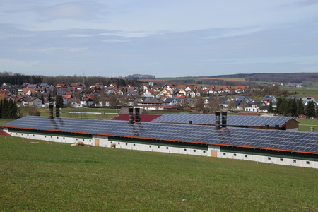 solar panels on the roof of a farm