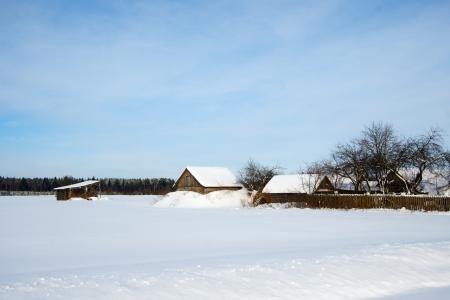 Winter rural landscape with a village photo
