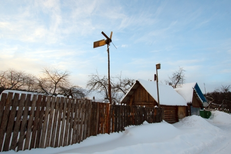 Winter rural landscape with village and vane photo