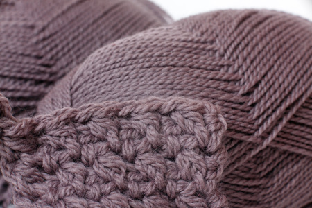 skein of yarn mocha color closeup and knitting photo