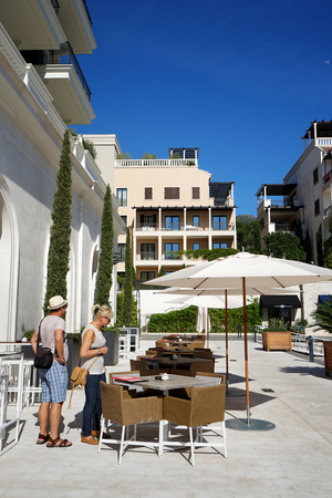 april 15: Tivat, Montenegro, April, 15, 2016: Cafe on the waterfront in Porto Montenegro, Tivat. Editorial