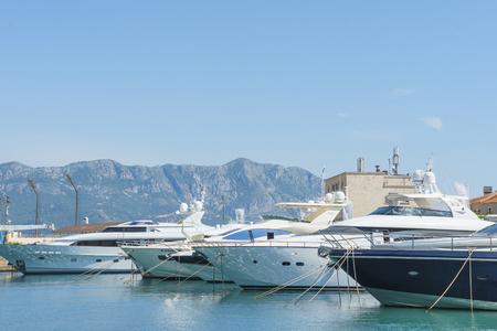 passenger ships: Budva, Montenegro, May, 09, 2016: Boats and passenger ships stand on an anchor in Budvas harbor