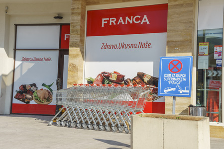 famous industries: Budva, Montenegro, May, 09, 2016: Exterior of low-price supermarket Franca Editorial