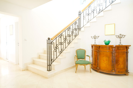 Interior of a hall with stairs in mini-hotel