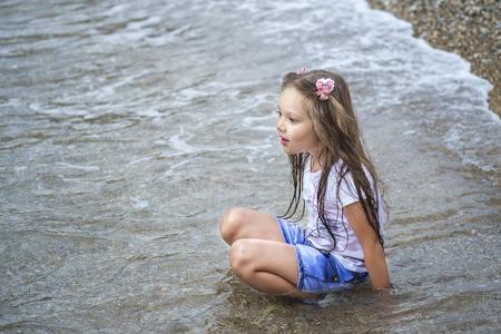 Brown hair girl on beach