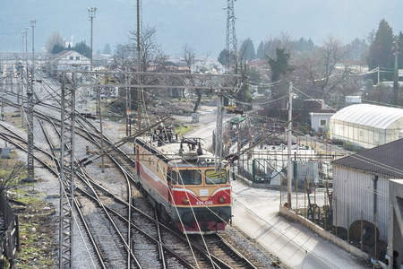 Bar, Montenegro, January, 24, 2019: Top perspective view on a railway branching. Sort Facility. Railroad tracks and entrances. Weaving the rail in front of the train station. Railway junction. Locomotive approaching the railway station Zdjęcie Seryjne - 122737028