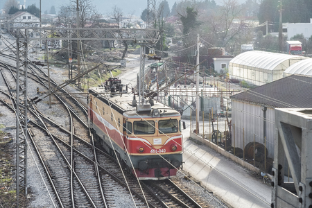 Bar, Montenegro, January, 24, 2019: Top perspective view on a railway branching. Sort Facility. Railroad tracks and entrances. Weaving the rail in front of the train station. Railway junction. Locomotive approaching the railway station Zdjęcie Seryjne - 122737029