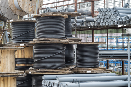 Building materials are exhibited for sale in the construction market in the open air