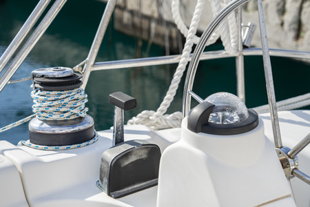 The deck of the yacht in a sunny day. Steering gear of the yacht close-up