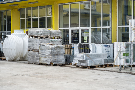 Bar, Montenegro, February 04, 2019: Construction materials are exhibited for sale in the yard of a building materials store in the open air