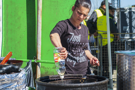 Virpazar, Montenegro, March, 24, 2019: Festival of wine and fish in the Montenegrin town Virpazar. Montenegrins fry and sell fish on the street for festival guests Editöryel