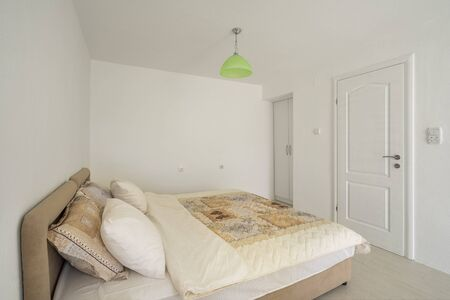 Interior of a bedroom n light colors in a private apartment