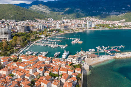 Aerial shot of the marina of a small Adriatic town, aerial view of yachts and boats in marina. Budva, Adriatic sea, Montenegro Standard-Bild