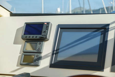 Close-up view to a dashboard with navigation system of modern luxury yacht in the captain's cockpit Stok Fotoğraf