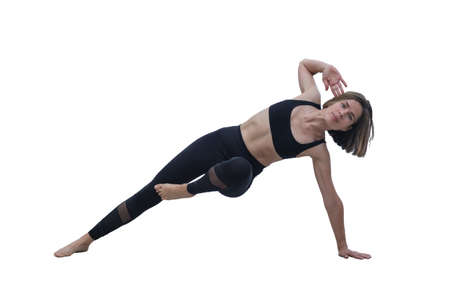 Young slim beautiful woman practicing yoga, exercising, making yoga pose, isolated on the white background Stok Fotoğraf