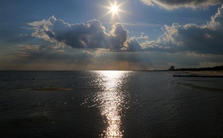 Setting sun over water