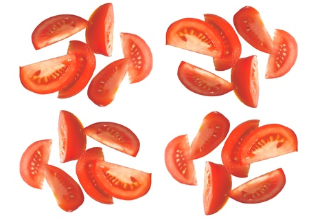 falling juicy slices ripe tomatoes over white background photo