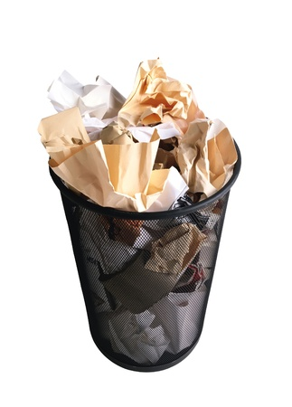 wastepaper basket: Black garbage bin with paper waste isolated on white background Stock Photo