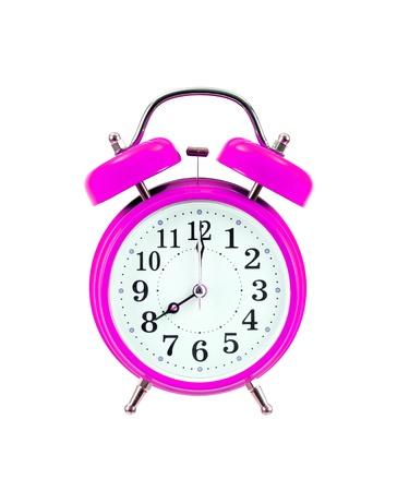 pink vintage alarm-clock isolated on white background
