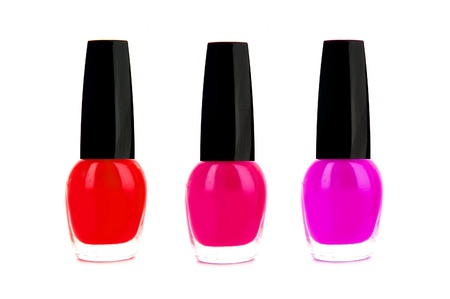 fangle: Pink and red nailpolish isolated on white background