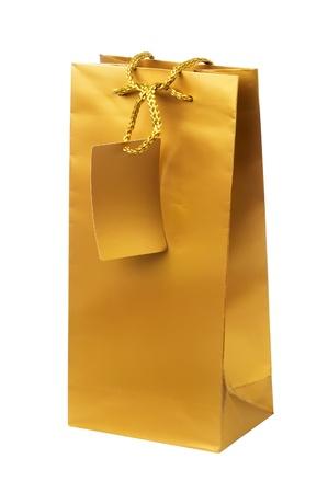 Golden gift shopping bag isolated on white photo