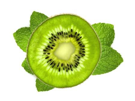Fresh kiwi slice over mint leaves isolated on white background photo