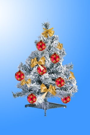 decorated christmas tree over blue background photo