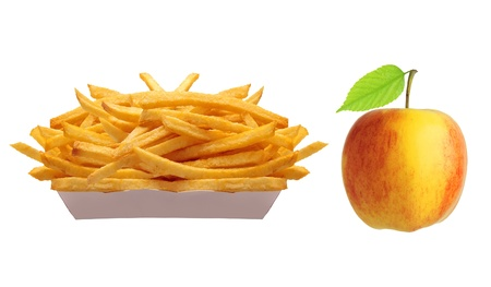 French fries in white box and yellow apple with green leaf isolated on white photo