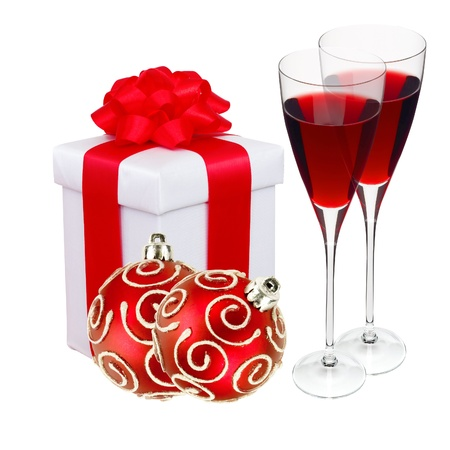 Beautiful gift in white packaging, two wineglass and red christmas balls isolated on white photo