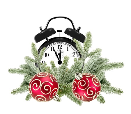 Green Christmas tree, decorative red balls and alarm clock isolated on white photo