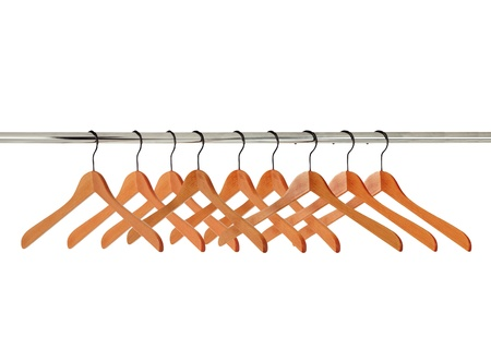 closet rod: wooden clothes hangers isolated on white