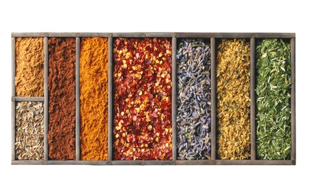 spices in wooden box isolated on white photo