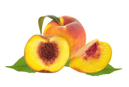 Fresh juicy peaches over green leaves isolated on white background photo