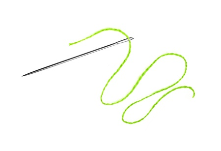 needle and thread: Green thread and needle isolated on white