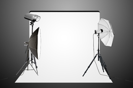 Empty photo studio with lighting equipment photo