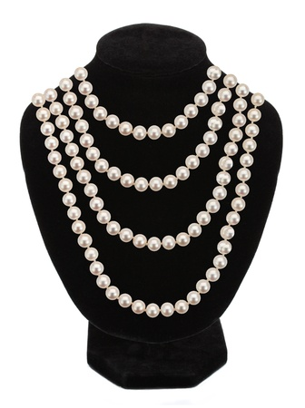 Pearl necklace on black mannequin isolated on white background photo